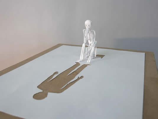 Sitting Skeleton Paper Cutout